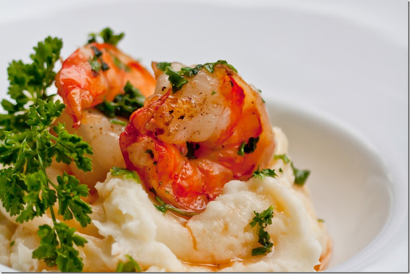 Shrimp Scampi is made of shrimp or prawns that are cooked in butter and wine sauce with lots of garlic and fresh parsley. The sauce that surrounds the shrimp is absolutely amazing. You will want to soak up every little tiny bit of it with some good crusty bread.