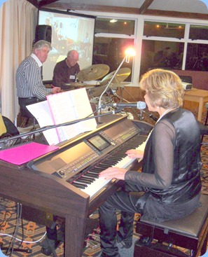 Carole Littlejohn singing with Len Hancy and Ian Jackson keeping the beat and Peter Brophy adding keyboard harmonies.