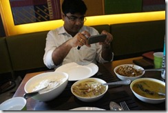 Rwitankar eating the modern Bengali way