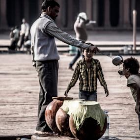 water by Suman Sengupta - People Street & Candids ( water, drinking, motionstopper, rawshooter, suman, agra, candia, india, sengupta, sumansengupta, people )