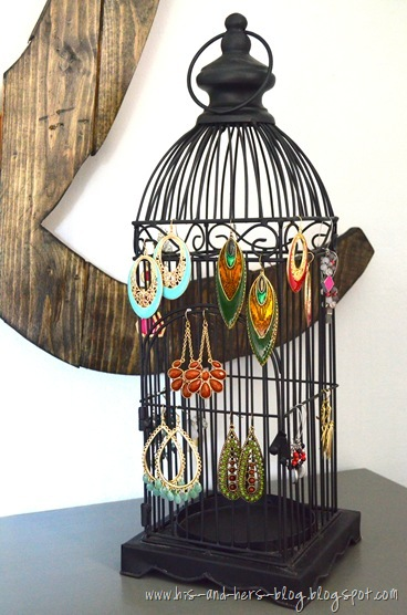 use a birdcage to display earrings
