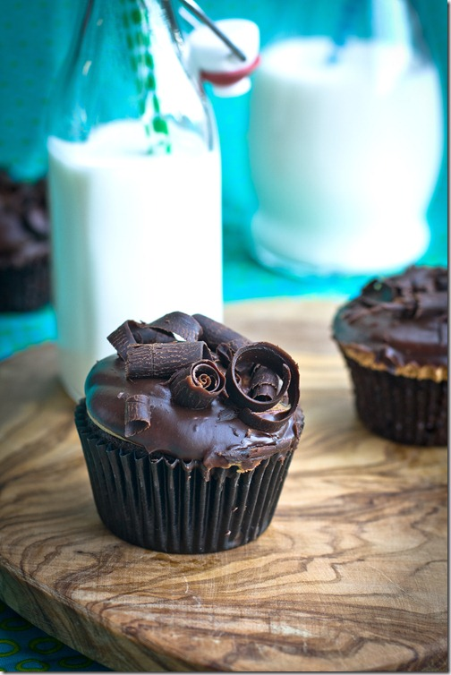 Chocolate Cupcake with Peanuts is topped with Dulce de Leche Buttercream, then dipped in chocolate and covered with chocolate curls. The most amazing thing to happen to a cupcake, for sure!