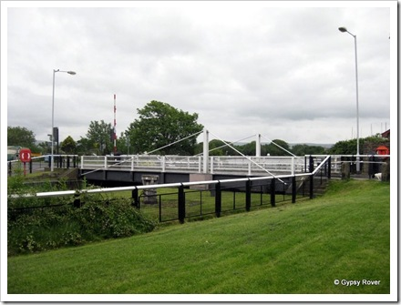 Road swing bridge across the lock up into the canal basin. Glasson dock.