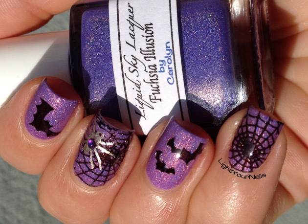 Purple holographic Halloween nail art