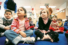 Pre-kindergarten students participate in activities at Carlin Springs Elementary School in Arlington, Va., Thursday, March 8, 2007.  From left are, Jose Chavez,  Danielle Moreno, and Lilli Anne Morris. (AP Photo/Gerald Herbert)