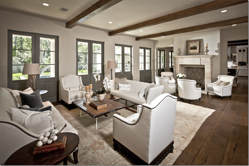 The Beamed Living Room Is Divided Into Two Areas One Around Sofas And Other Fireplace Past Kitchen