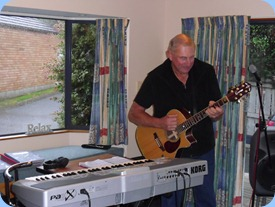 Kevin Johnston playing guitar and accompanied by a backing arrangement on the Korg Pa1X. Whilst Kevin played we all enjoyed a sumptuous lunch including freshly caught snapper both crumbed and smoked and courtesy of Kevin Johnston the fisherman!
