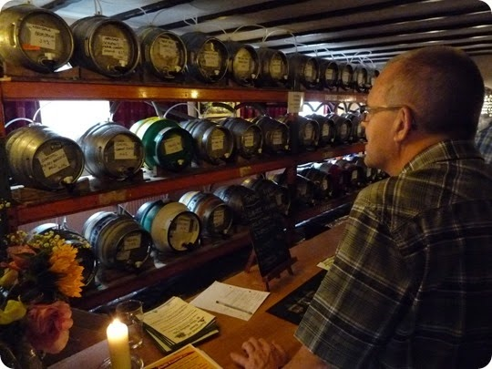 A visitor views the cask ales inside The Globe Pub