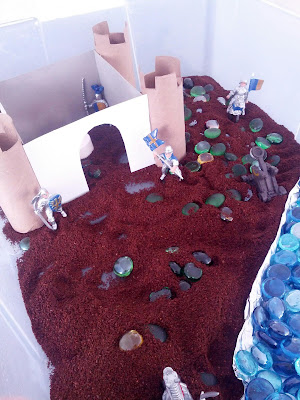 Medieval sensory bin for kids from And Next Comes L