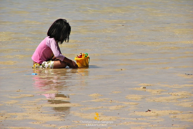 Kids Busy on the Sand at Sab-Itan Laya Island in Caramoan