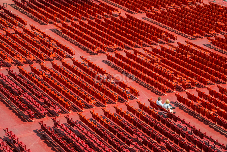 Red Chairs by Dobrinovphotography Dobrinov - Abstract Patterns ( full frame, sports venue, plastic, in a row, open-air theater, large group of objects, chair, red, metal, seat, no people, event, outdoors, stadium, empty, auditorium, repetition, green )