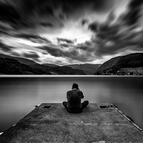 Waiting by Rio Tanusudiro - Black & White Landscapes ( mountain, b&w, waterscape, bw, cloudy, long exposure, lake, light, people, dock, man, fjord,  )