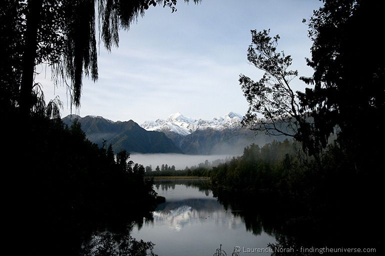 Mirror lake reflection Lake Matheson southern alps New Zealand