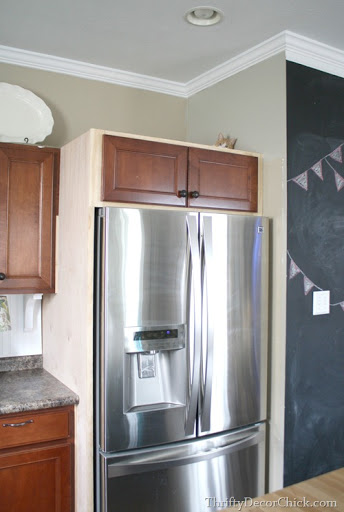 building in a fridge with cabinet on top from thrifty decor chick rh thriftydecorchick com diy refrigerator cabinet door diy cabinet above refrigerator