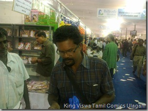 CBF Day 13 Photo 49 Stall No 372 Another Regular comics reader Buying Comics
