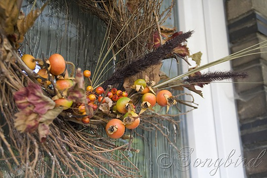 Fall Twig Wreath with Orange Berry Decorations