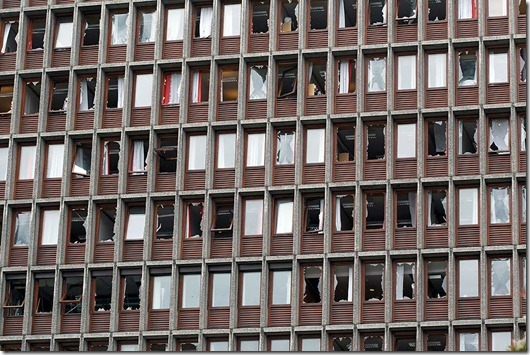 Shattered windows of a major building after an explosion in Oslo, Norway, Friday July 22, 2011. A loud explosion shattered windows Friday at the government headquarters in Oslo which includes the prime minister's office, injuring several people.  Prime Minister Jens Stoltenberg is safe, government spokeswoman Camilla Ryste told The Associated Press. (AP PHOTO / Berit Roald, Scanpix) NORWAY OUT