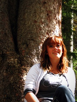 Kelcie sitting by a tree in Big Cottonwood Canyon Utah