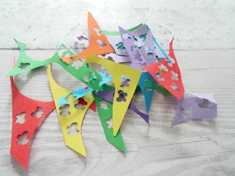 How to make your own confetti paper scraps with butterflies punched through with a paper punch