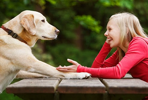 getty_rf_photo_of_girl_relaxing_while_talking_to_dog.jpg