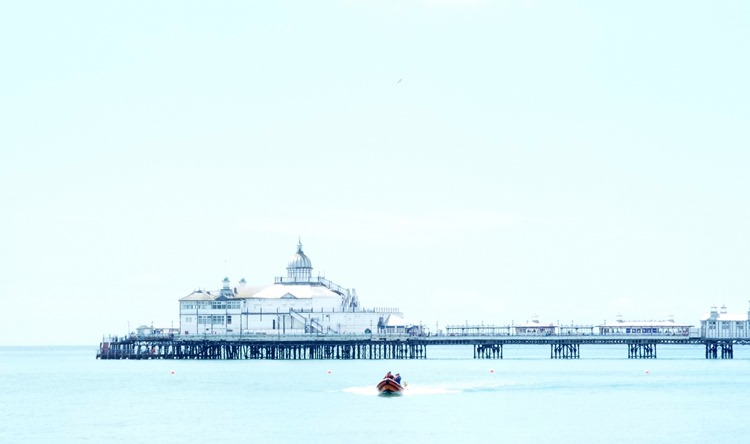eastbourne pier high tide with life boat