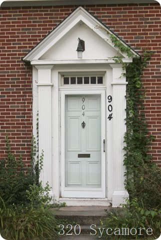 white door   brick   vine