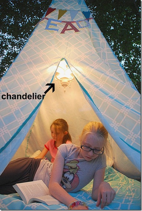 reading teepee tent at night with chandelier