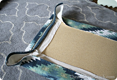 rug on upholstered cushion