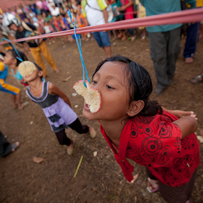Lomba Makan Kerupuk by Kosmas Fikie Aryadi - Babies & Children Children Candids ( cultural heritage, indonesian, indonesia tourism, indonesia, child photography, child portrait, children, independence day, culture )