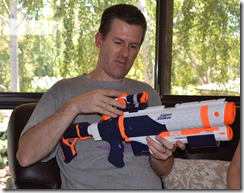 David unwrapping a super-soaker water pistol