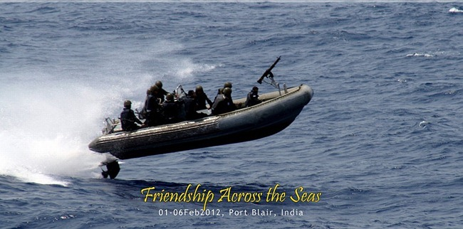 Commandos of the Indian Navy, the MARCOS, lifted off the water, charging ahead aboard their rigid-hull inflatable boat.
