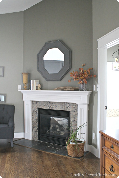 gray and green mosiac tile surround on fireplace