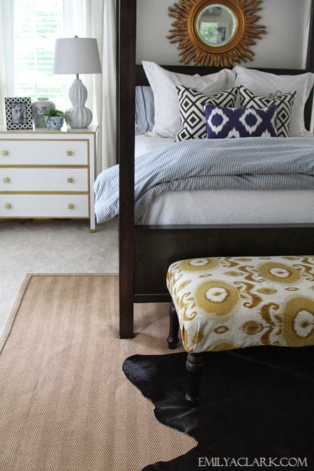 layered sisal and cowhide rugs