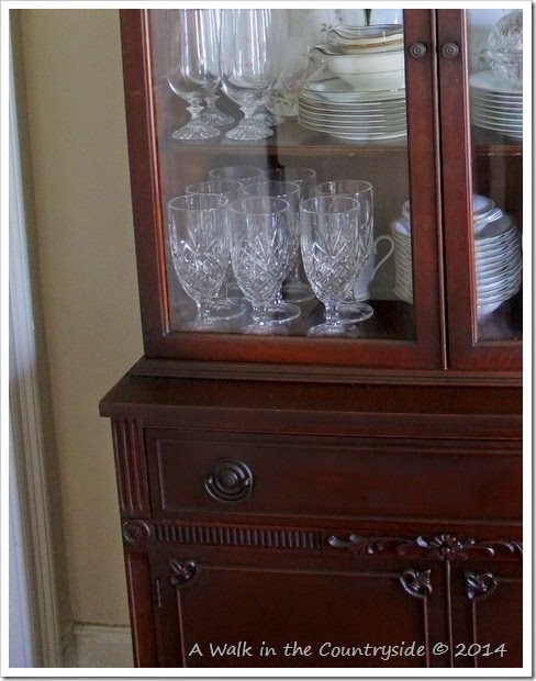 fleur de lis accent on china cabinet