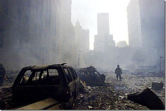 tn_A_firefighter_walks_amid_rubble_near_the_base_of_the_destroyed_World_Trade_Center_in_New_York_on_September_11__2001
