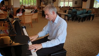 Claude Moffat playing the grand piano. Photo courtesy of Dennis Lyons.