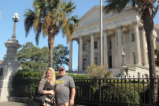 Ally and Jim in front of Custom house in Charleston