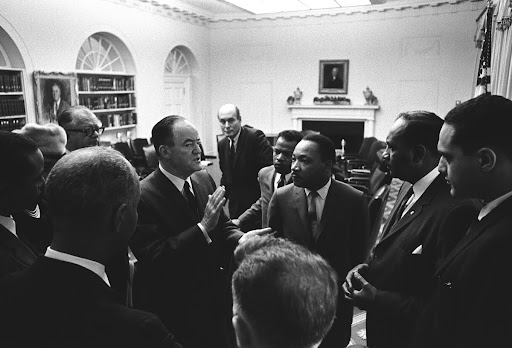 Vice President Hubert Humphrey speaking after the meeting. (Clockwise from him): Attorney General Nicholas Katzenbach, John Lewis, Rev. Martin Luther King, Jr., Clarence Mitchell, Clifford Alexander, Dave Brody (?), Roy Wilkins, Floyd McKissick (?), Dorothy Height, Andrew Biemiller.