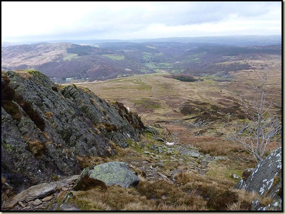 A view to Capel Curig from the lower part of the NE ridge - a grassy corridor between fins of slate