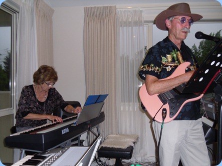 Denise Gunson joined by her 'Country and Western' husband, Brian on electric guitar and vocals. Very nice team!