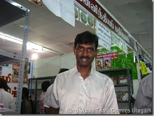 CBF Day 13 Photo 31 Stall No 372 getting his own copy of CBS gives him the joy
