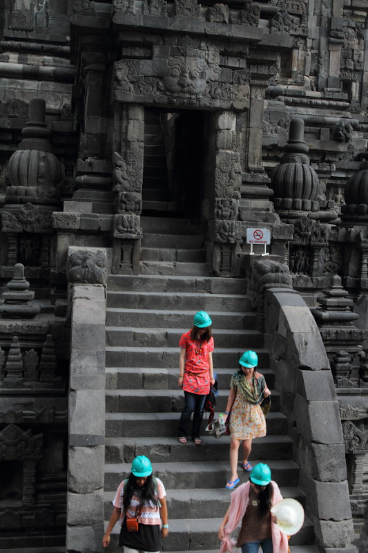 Safety helmets worn by female tourists visiting the Siva complex in Prambanan