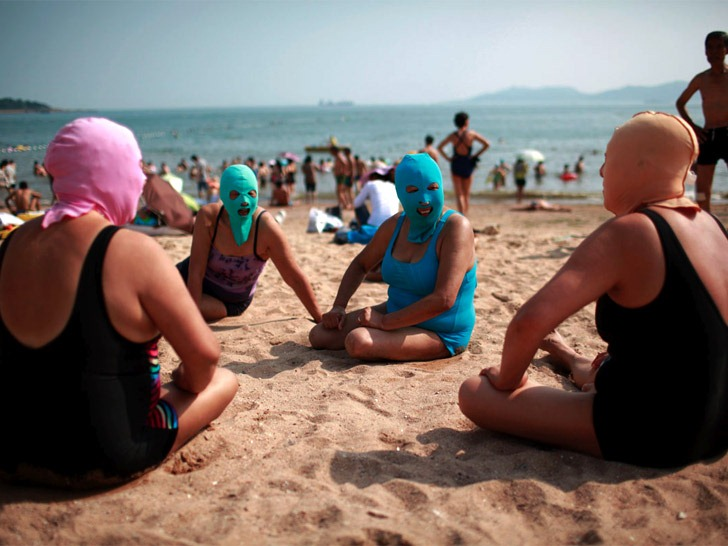 Naked girls in qingdao china The Latest Chinese Beach Craze Face Kini Amusing Planet