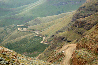 "Looking down the road from the ""Roof of Africa"" - Sani Pass photo gallery"