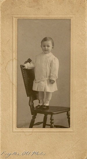 Child in Chair in cute shoes DL Antiques