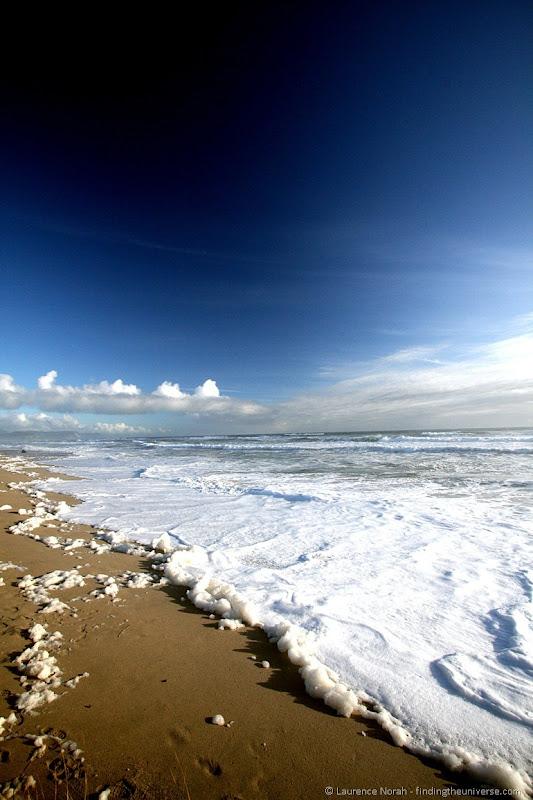 South Island New Zealand - Foamy beach near Karamea