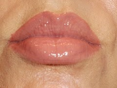 NYC New York Smooch Proof Lip Stain in Never Ending Nude with clear gloss on top.