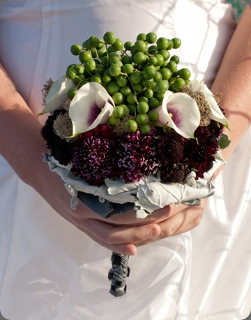 euro-bridesmaid-1 biedermeier clutch bouquet consisting of rolled dusty miller, calla lilies, deep purple scabiosa and china berries floral design by jacqueline ahne