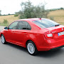 2013-Skoda-Rapid-Sedan-Red-Color-13.jpg