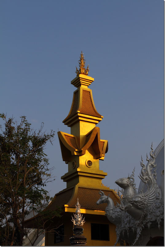 Golden tower next to White Temple, Chiang Rai